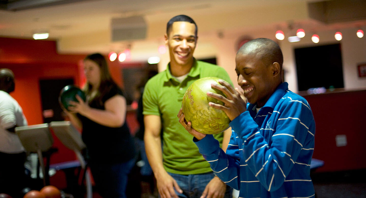 Happy young people bowling