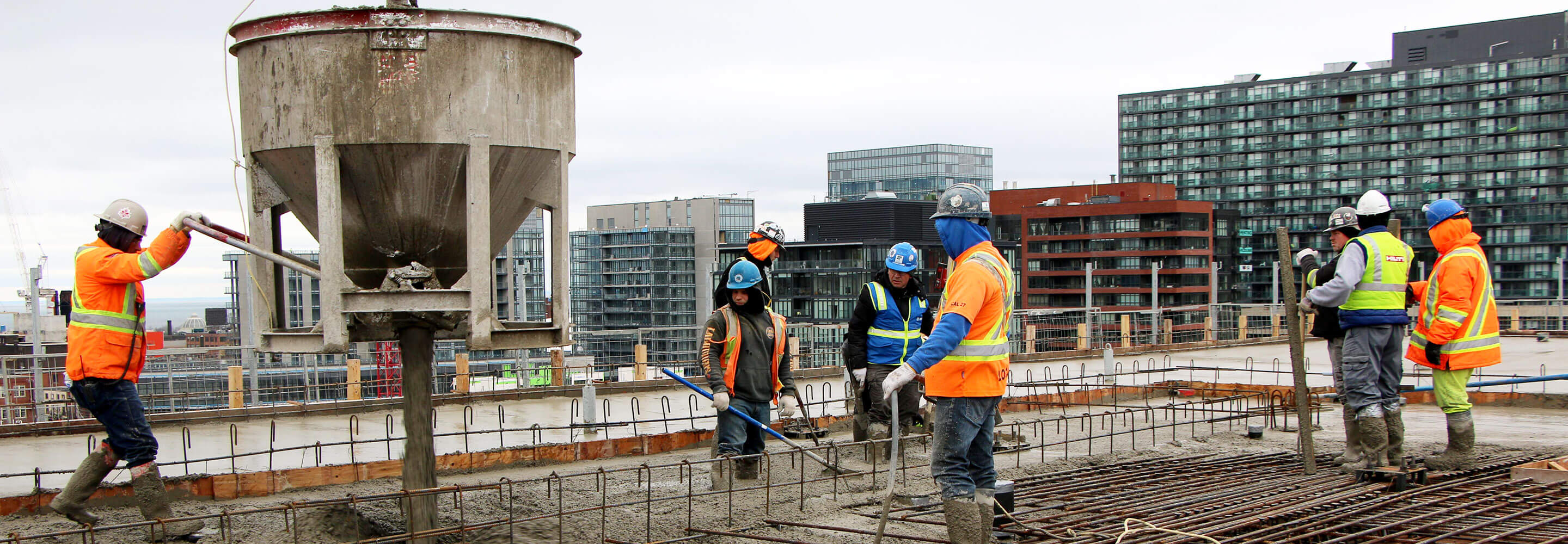 Man pouring concrete - top-off Phase 1C