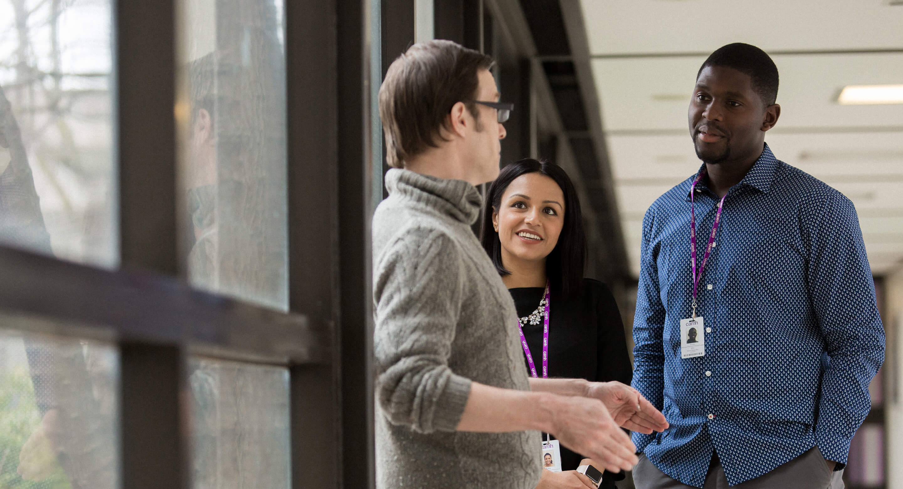 CAMH staff members converse in the hallway.
