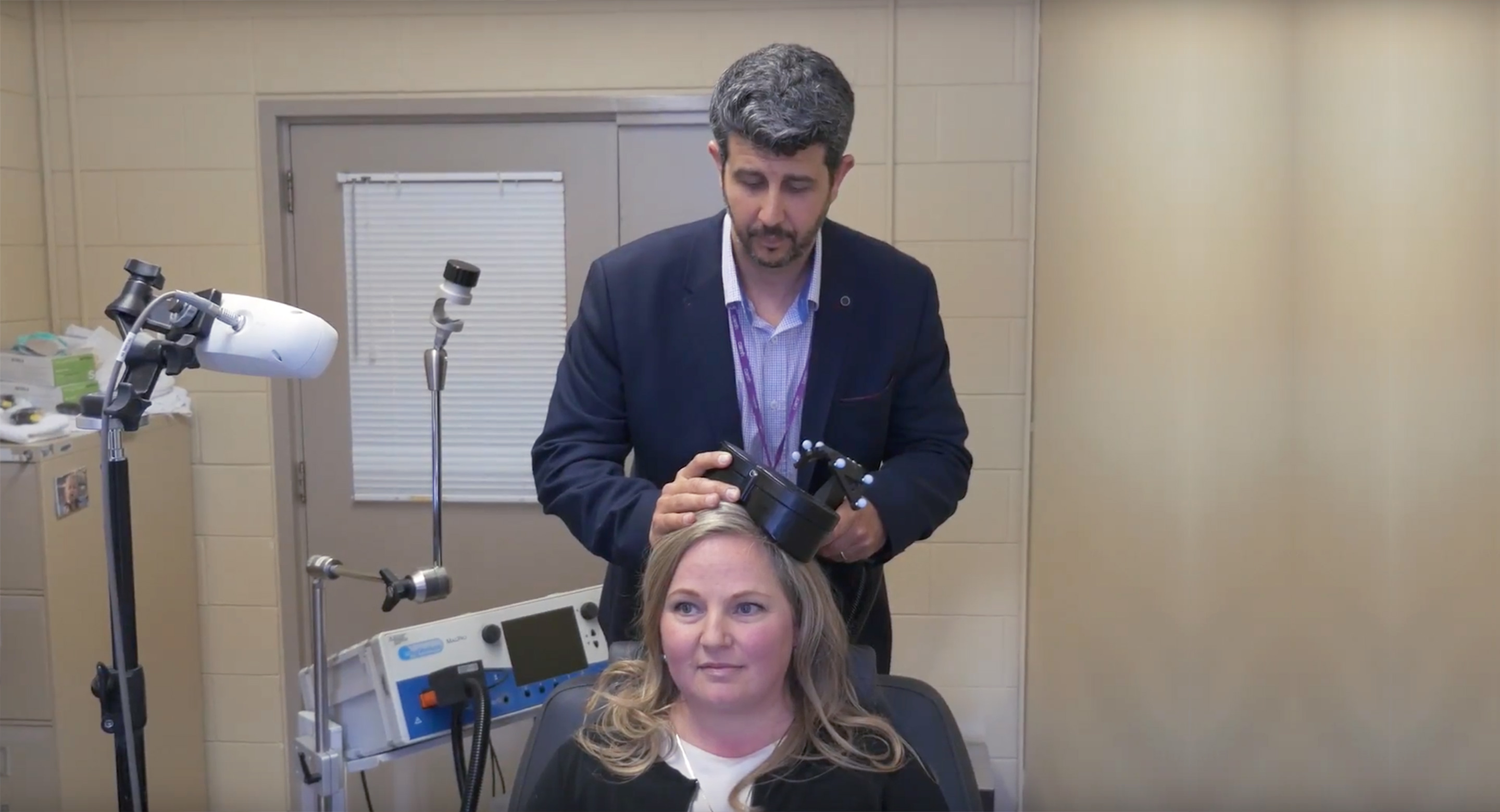 Dr. Daniel Blumberger demonstrates intermittent theta burst stimulation