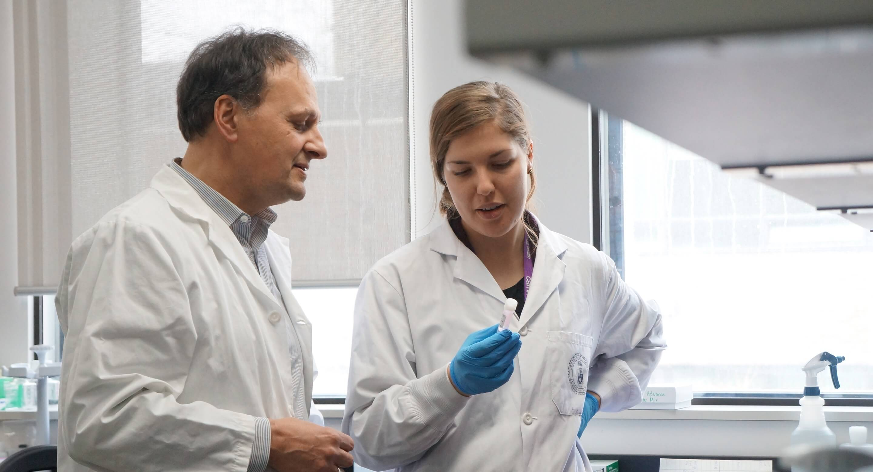 Dr. Etienne Sibille in the lab with another researcher