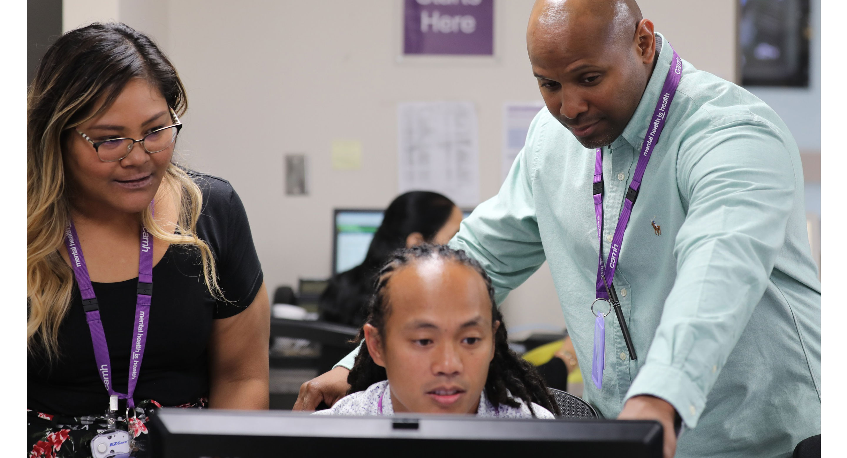 Staff looking at computer at CAMH's Gerald Sheff and Shanitha Kachan Emergency Department