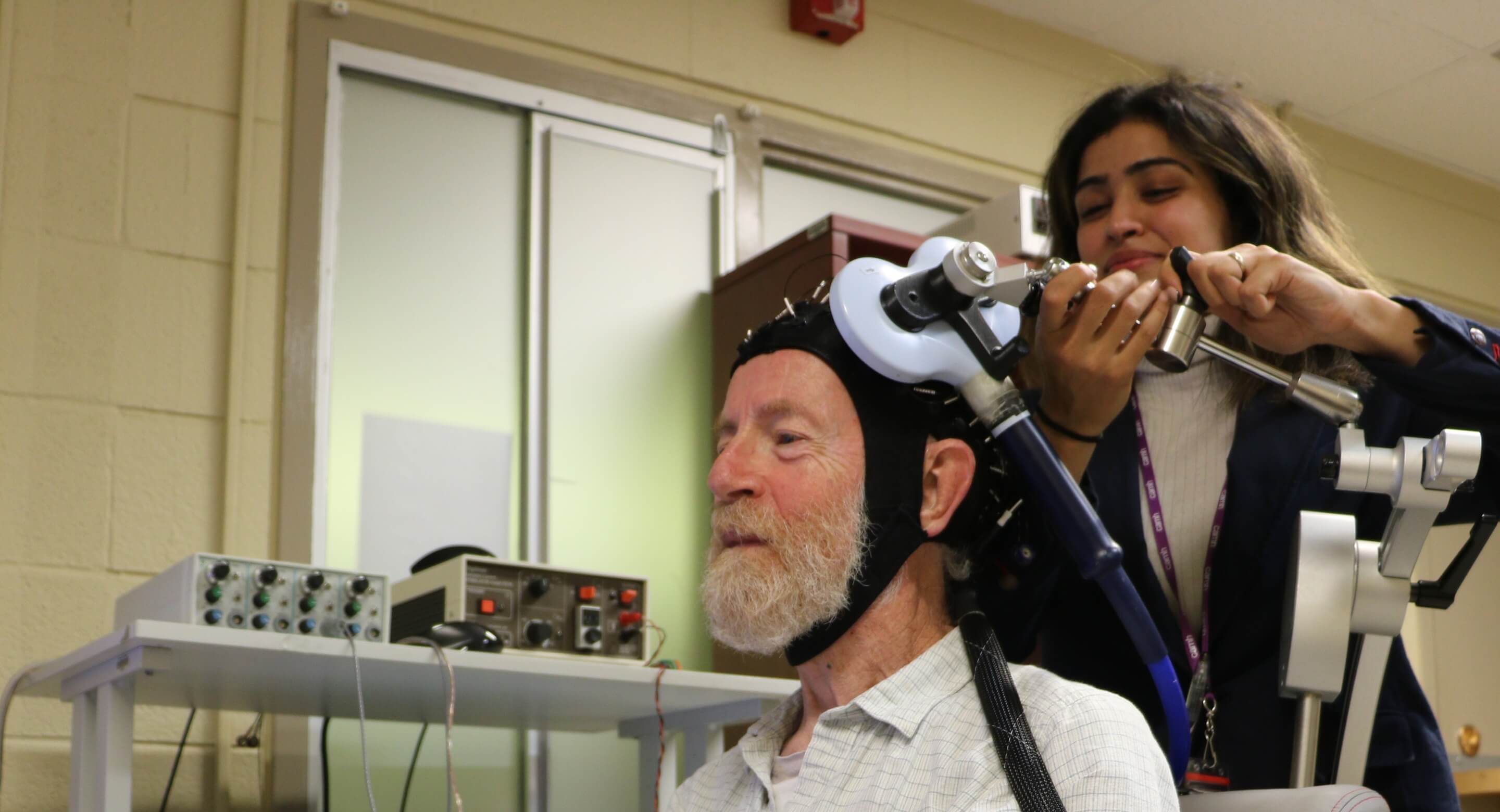 Don Palmer, a research volunteer, and Apoorva Bhandari, Research Analyst in Geriatric Psychiatry at CAMH, demonstrate the innovative, CAMH-developed approach to study brain plasticity in the frontal lobes